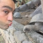 """Yiannis """"talking"""" to a giant tortoise"""