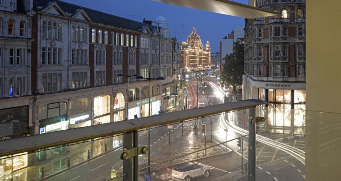 Balcony view at dusk looking towards Harrods, One Hyde Park, Luxury Flats, Europe, United Kingdom, 2011, Rogers Stirk Harbour + Partners. (Photo by View Pictures/UIG via Getty Images)